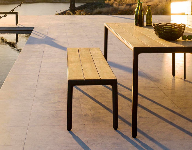 Outdoor Wrought Iron and Teak Setting. ILLUM Garden bench by TRIBÙ design.