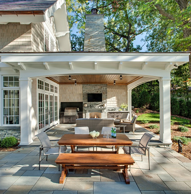 Patio. Combination of open patio and covered patio with outdoor kitchen and outdoor fireplace. #patio John Kraemer & Sons.