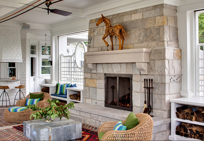 Porch Fireplace. Porch Fireplace Design Ideas. Porch with stone fireplace and built in benches on both sides. #porch #fireplace Wade Weissmann Architecture. David Bader Photography.
