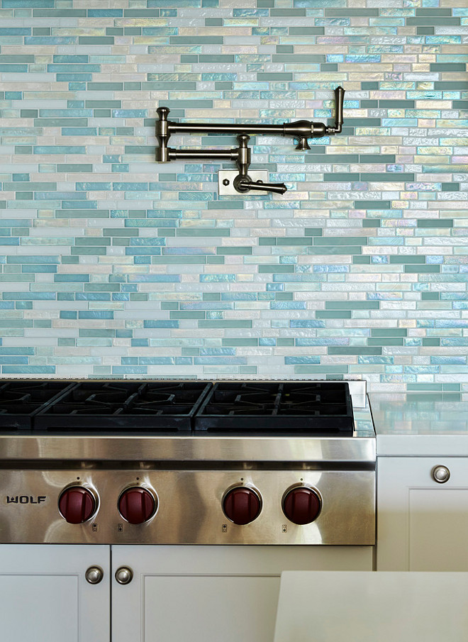 "Sea Glass Tile Backsplash. Beach house Sea Glass Tile Backsplash. Blue Sea Glass Tile Backsplash. Blue Shimmer Backsplash. The big star of this kitchen is the turquoise 1"" x 4"" shimmery backsplash tile. #SeaGlassTile #Backsplash #kitchen #beachhouse JMA Interior Design."
