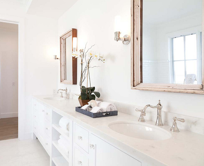 White Bathroom Cabinet. How to design a white bathroom without making it feel cold. #WhiteBathroom Graystone Custom Builders.