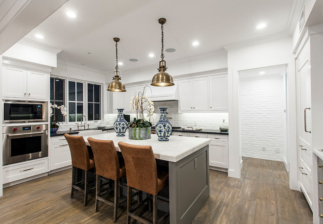 White Kitchen gray island. White coastal kitchen with gray island and painted brick backsplash. White Kitchen. #WhiteKitchen #CoastalKitchen #Grayisland Blackband Design.