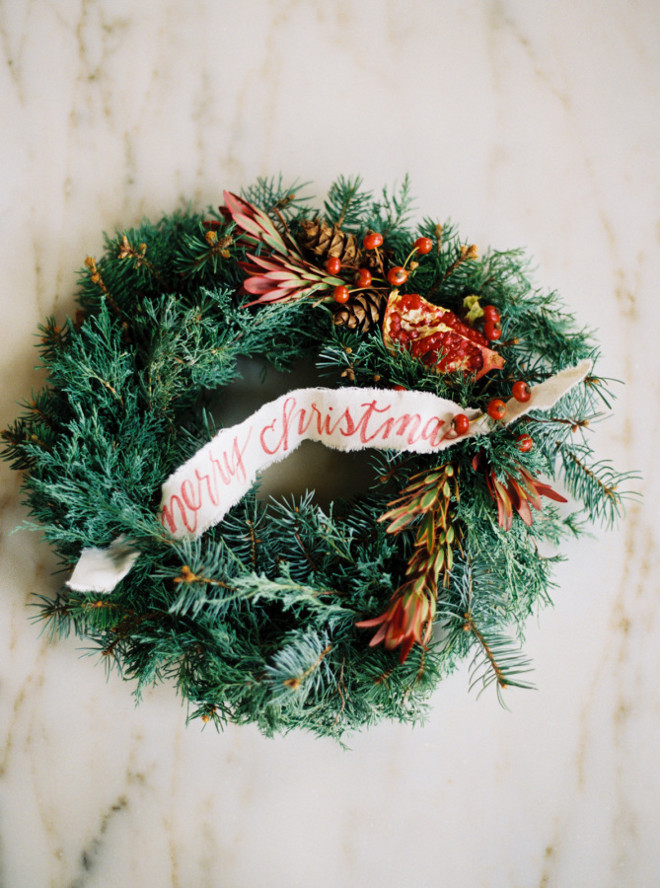 Merry Christmas Wreath. Merry Christmas Wreath Ideas. DIY Merry Christmas Wreath. #DIYChristmas #DIYWreath #MerryChristmas #ChristmasWreath #ChristmasDecor #Christmas Rachel Gomez Photography via Style me Pretty.