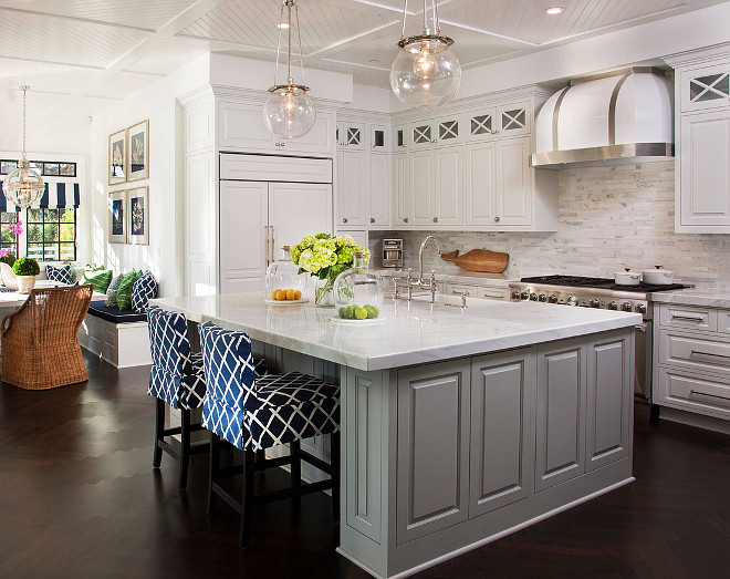 White kitchen cabinet with gray island paint color. The island is Sherwin Williams Mindful Gray 7016 and the cabinets are Sherwin William Pure White 7005. #SherwinWilliamsMindfulGray #SherwinWilliamsSW7016 #SherwinWilliamPureWhite ##SherwinWilliamSW7005 AGK Design Studio.