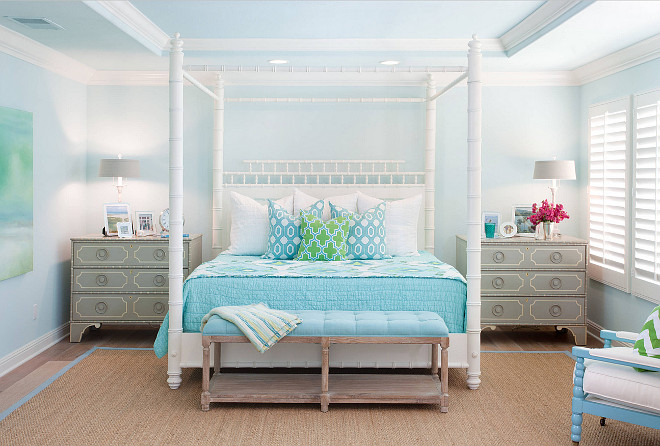 Coastal Bedroom. Coastal Turquoise Bedroom. Coastal turquoise bedroom features a white faux bamboo canopy bed with pagoda headboard dressed in green and blue bedding flanked by gray nightstands, Somerset Bay Big Pine Key Chests, alongside a turquoise blue tufted bench placed at the foot of the bed atop a turquoise blue bound sisal rug. Bedding is from Nordstrom Home, the back two accent pillows are from Zgallerie and the front accent pillow is from Wisteria.