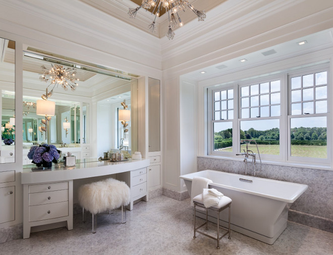 Master Bathroom. Elengant all white master bathroom with exotic light gray stone flooring. This is the ultimate master bathroom. #MasterBathroom #ElegantBathroom #Luxury #Interiors #exoticStone #Flooring #Allwhite Sotheby's Homes.