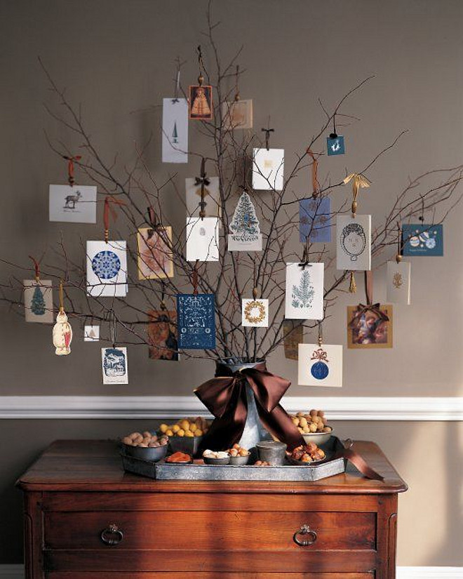 Christmas tree holding cards. Find lots of banches, put them in a vase and display your Christmas cards. This an easy and sentimental way to display your Christmas cards. #Christmas #Cards #Display #EasyChristmasDecor MARTHA STEWART.