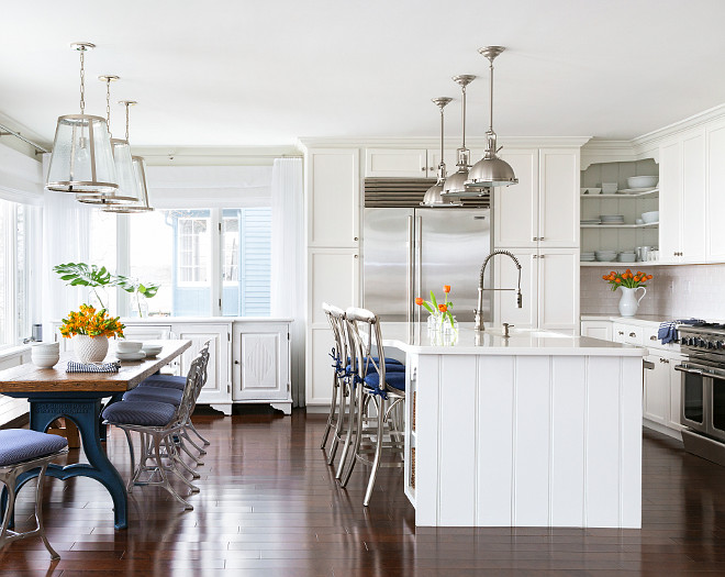Kitchen. White kitchen painted in White Dove by Benjamin Moore. Pendants above kitchen table are from Lighting Direct. Industrial table and dining chairs are antiques. Pendants above kitchen island are Hudson Valley Lighting Massena Transitional Pendant Light. #Kitchen #KitchenIdeas Chango & Co