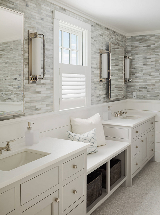 Bathroom with shiplap and wall tiles. Bathroom with white shiplap wall and tiles. Bathroom with shiplap and tile walls. A window seat is flanked by the his and hers sinks. #Bathroom #Shiplap #Tile #wall Sophie Metz Design.