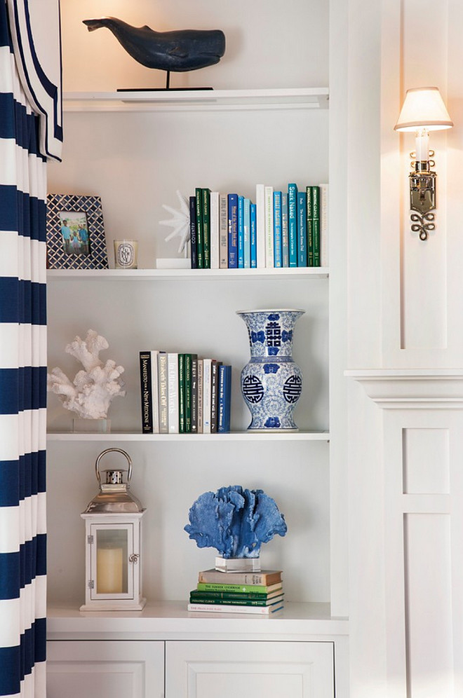 White Bookcase Paint Color. The white bookcase paint color is Sherwin Williams Pure White SW7005. This white paint color is a great crisp white that I often recommend to my own clients. You can use this crisp white on cabinets, but it is also perfect from trim work.