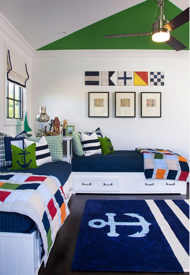 Nautical bedroom with Built in Bed. Kids bedroom with built in beds. What a great nautical bedroom! I am loving the nautical flags and the built-in beds. Shared kids bedroom with built in beds with storage under. The wall color is 8581 W Designer Grey by Frazee. #builtinBeds #Builtin #bed #Storagebed AGK Design Studio.