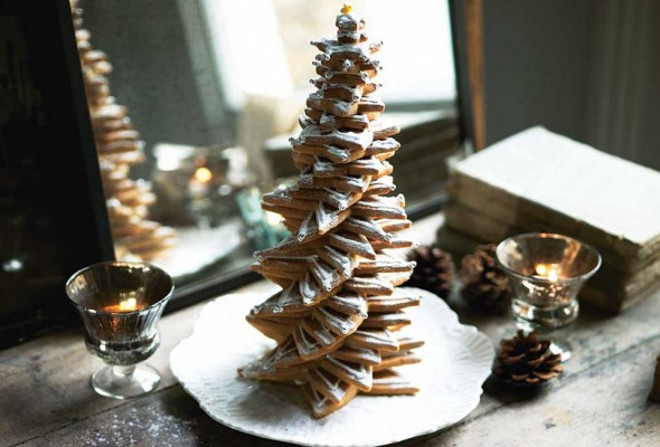 "Christmas Cookies. Christmas Tree of Cookies Recipe. This cookie ""tree"" is very simple but looks impressive. It's made up of a stack of little Christmas stars, which can be decorated and detailed or kept plain and simply dusted with confectioners' sugar. This is a great treat to make with children. Via Leite's Culinaria. Photo by Katie Hammond."