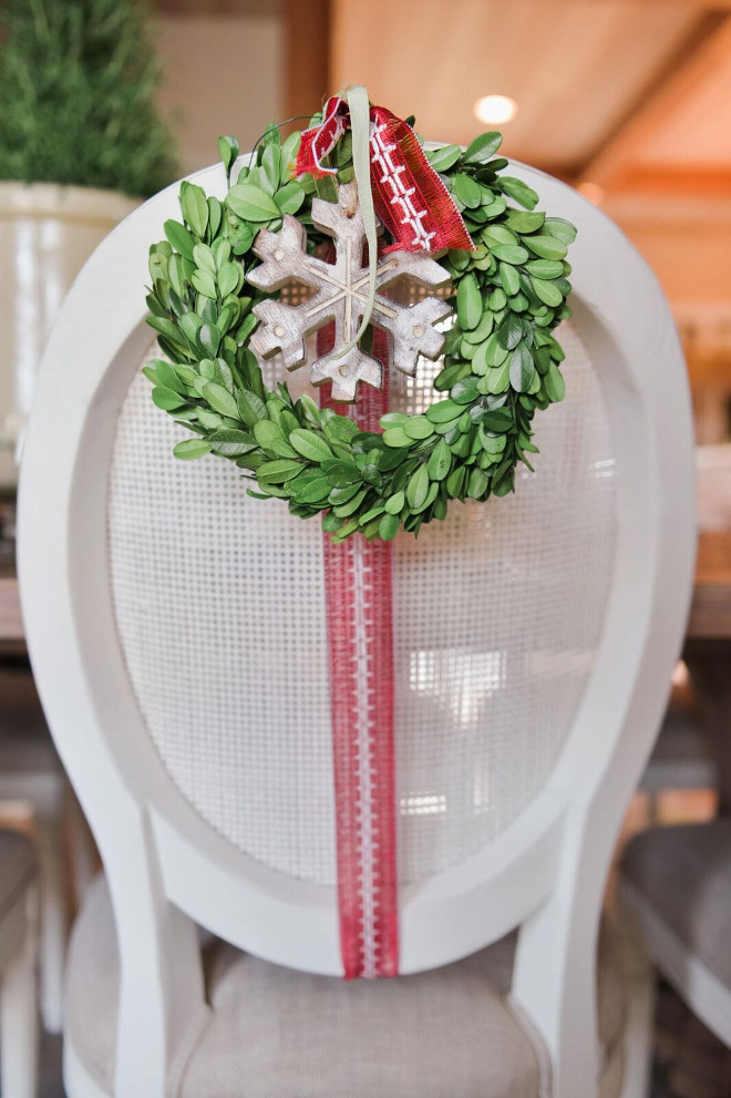 Christmas Dining Chair Decor Ideas. Dining chair decorated with wreath and Christmas ornaments. #Christmas #Chair #DiningChair #ornaments #wreath Gatehouse No.1.
