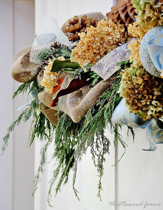 Christmas Mantel Decor. Swag greens with burlap and dried hydrangea. #Christmas #Mantel #Fireplace #Decor Castle Homes Via Thistlewood Farms.
