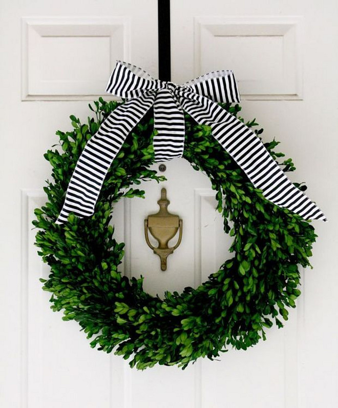 Christmas Wreath. Front door Christmas Wreath. Front door Christmas Wreath with simple striped black and white bow. #Christmas #Wreath By CRANE CONCEPT.
