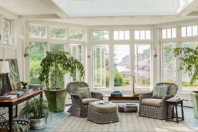 Conservatory Decor Ideas. Beautiful conservatory with garden and river view. The classic rattan wicker chairs can be used in both interior and exterior spaces and they are by gloster.