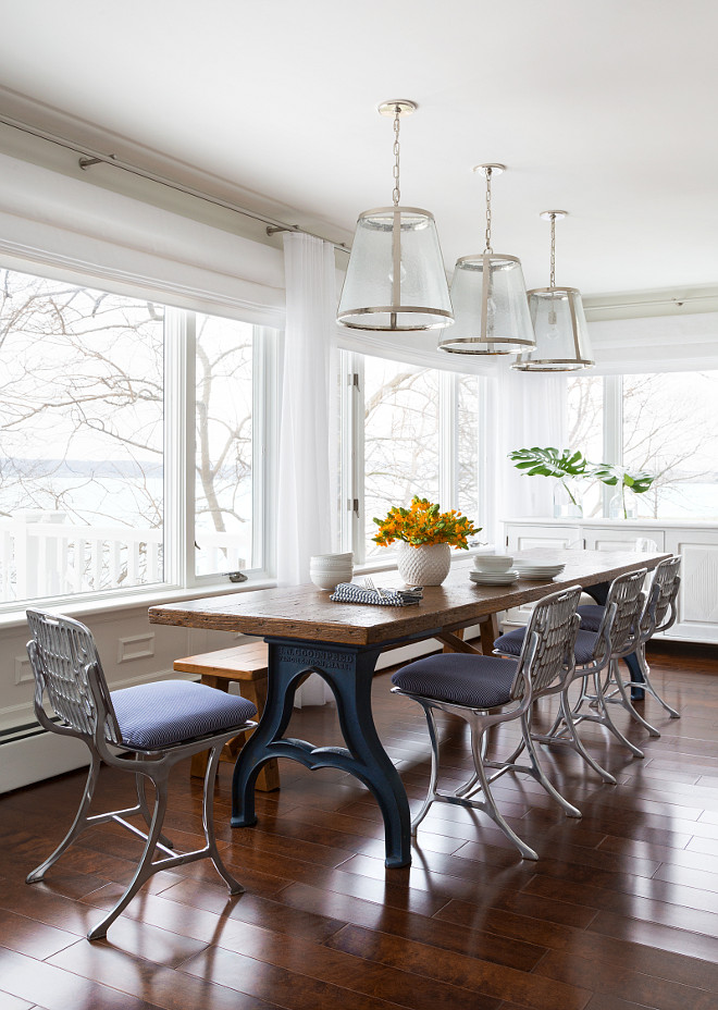 Industrial Dining Room Ideas. Perfect spot for a Sunday family lunch don't you think? Pendants above the dining table are from Lighting Direct. The industrial table was purchased from an antique dealer in Connecticut. The industrial chairs are limited in quantity but can sometimes be found on 1st Dibs. They are molded metal chairs made with the molds of 1930's Paris metro chairs. The chair cushions are made custom.