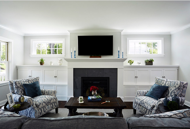 Living Room with windows above fireplace cabinet. #Livingroom #fireplace #Cabinet #windows Anchor Builders.