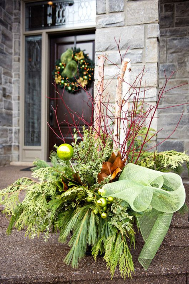Outdoor Christmas Arrangement. Beautiful Outdoor Christmas Arrangement Ideas. #Outdoor #Christmas #Arrangement #planter Via HGTV.