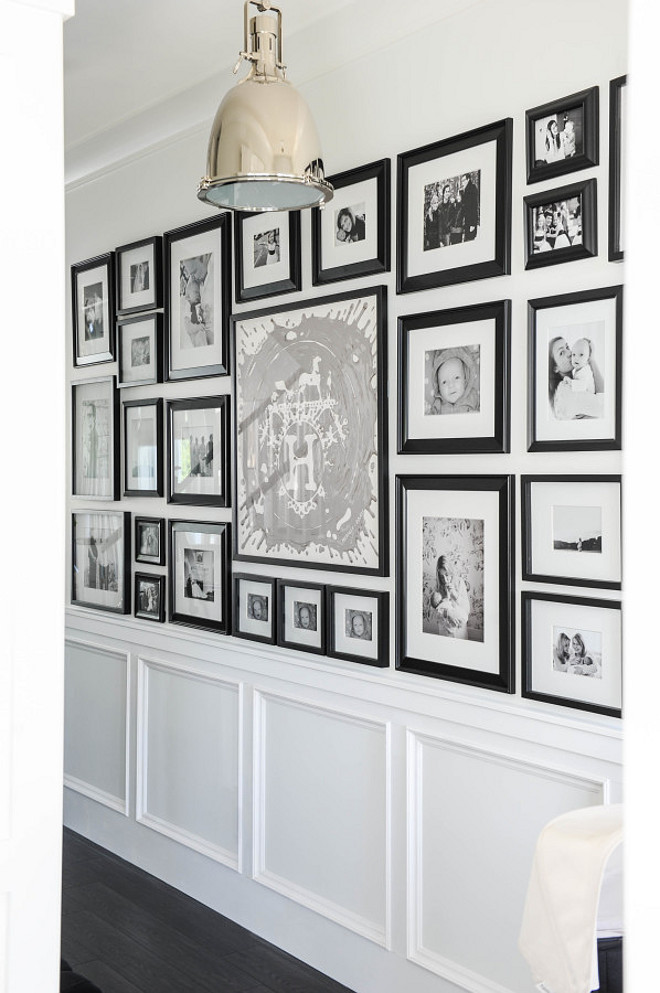 Photo Gallery Wall. Hallway Foyer with Photo Gallery Wall. Black and white Photo Gallery Wall. #PhotoGalleryWall Monika Hibbs.
