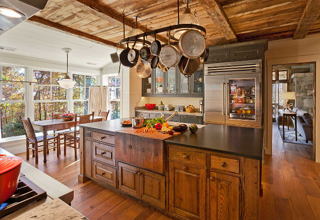 Rustic Kitchen. Rustic Kitchen Design. Rustic Kitchen Island. Rustic Kitchen Island Butchers Block. The cabinets of this rustic kitchen and the island are made of antique oak.