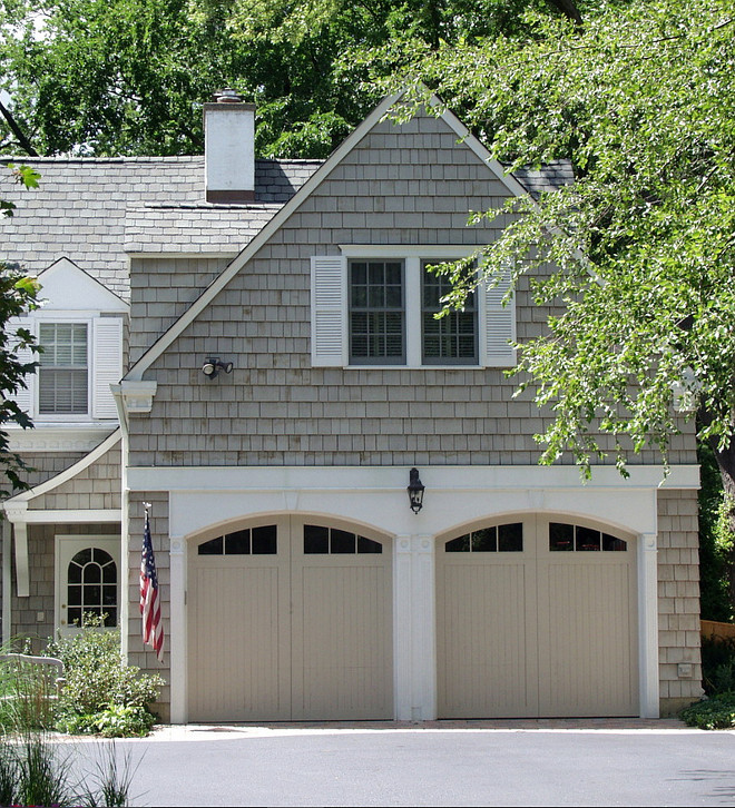 Garage doors are painted cedar. The paint color was custom mix to match the siding stain which is Cabot 'Driftwood Grey'. The siding stain is semi solid and has weathered so looks slightly different than the door color which is a solid color paint. #Garage #Door #PaintColor Brehm Architects.
