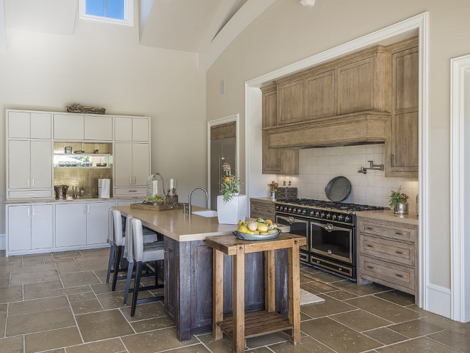White oak kitchen. French kitchen with White oak kitchen cabinets and island with French Limestone Floor Tiles and French Range. #Whiteoakkitchen