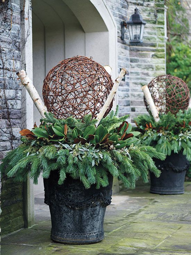 Winter Planter in front of garage. #Winter #planters #garage Via Canadian Gardening.