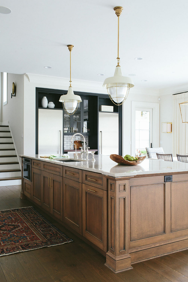 Kitchen island. Stained wood kitchen island. Stained wood kitchen island with white and brass pendants. Stained wood kitchen island. #Stainedwoodkitchenisland #kitchenisland #woodkitchenisland #island #woodenisland stainedwoodisland Kate Marker Interiors.