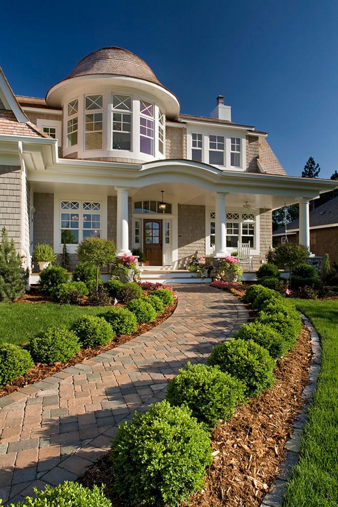 Single home porch. Cedar Shake Shingle Home. The siding is cedar shake shingle. #CedarShakeShingleHome Pillar Homes. #CedarShakeShingleHome Pillar Homes.