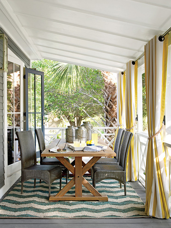Dining Porch. Dining Porch Ideas. The porch base is painted Kendall Charcoal, the floor is painted Chelsea Gray, and the ceiling is painted Cloud Cover, all by Benjamin Moore. The furniture is by Lloyd Flanders, and the fabrics and throw are by Sunbrella. #DiningPorch