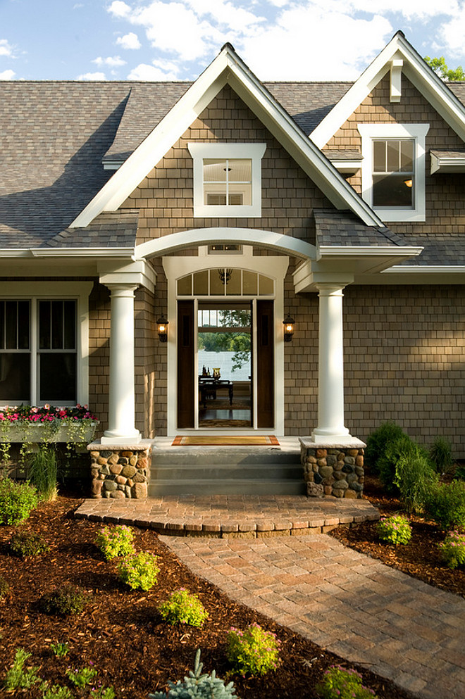 Arched Entry. Shingle lake house with white trim and Arched Entry. #ArchedEntry Pillar Homes.