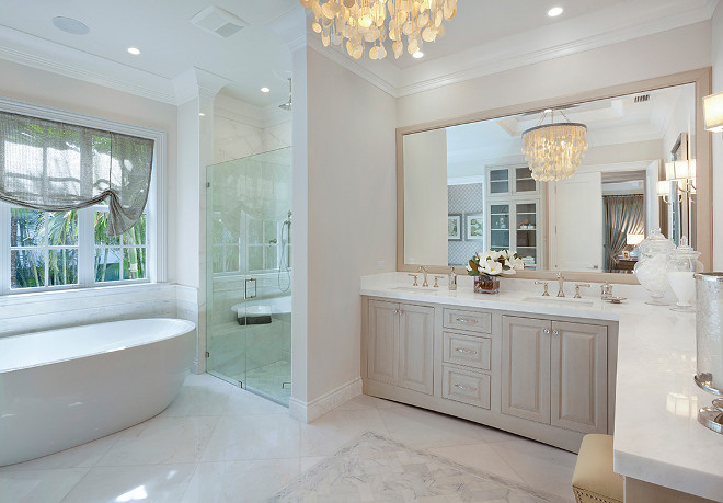 Bathroom. Neutral bathroom. Neutral, soft, transitional master bathroom with a sheer roman shade, Made Goods Henry Capiz Chandelier and marble counters. #Bathroom #Neutralbathroom
