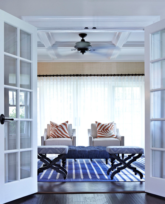 Blue and white room with coral. Coastal interiors with blue and white accents with coral. #blueandwhite #coastal #coral