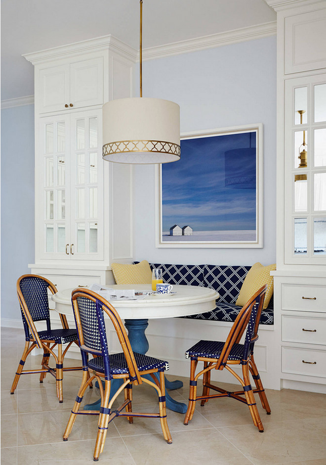Breakfast Nook with bench flanked by cabinets. Andrew Howard Interior Design.