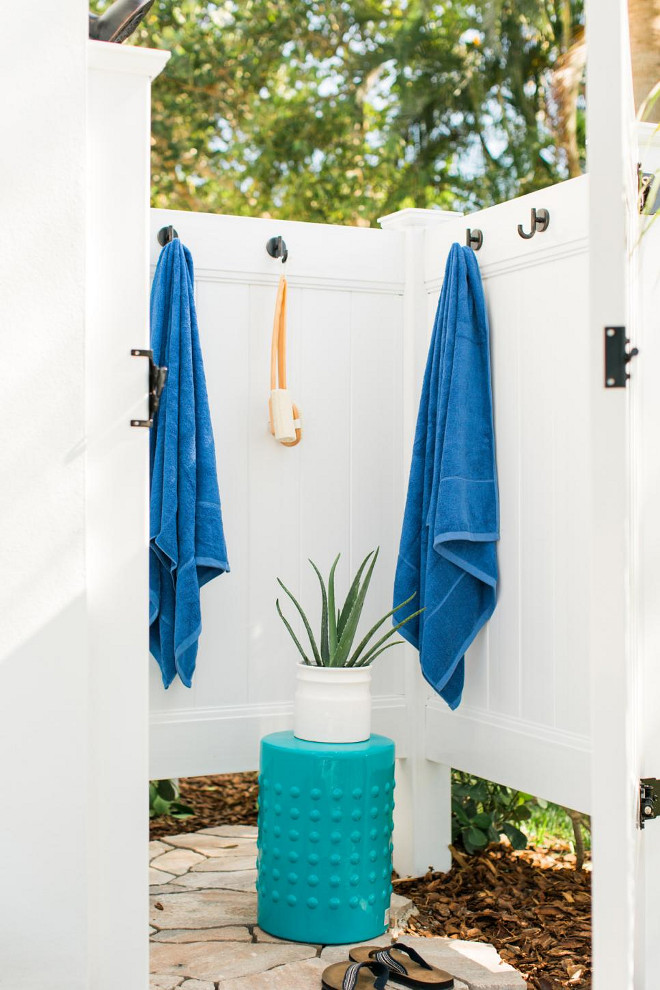 Closed Outdoor Shower. A wide door to the outdoor shower tucked into the corner of the back patio allows for privacy when in use.