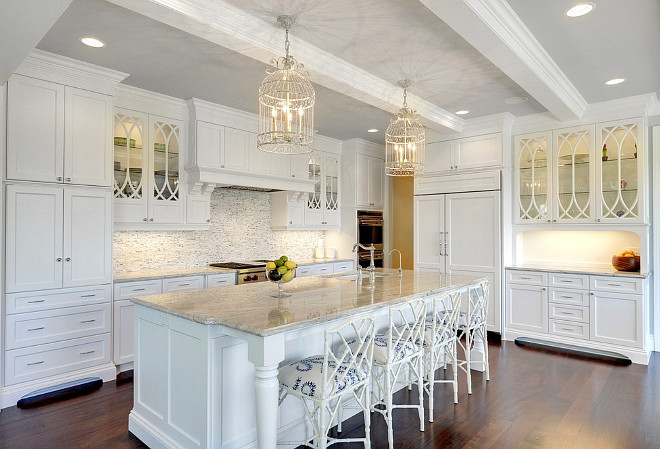 Crisp white kitchen. Large crisp white kitchen with faux bamboo counter stools from Ballard Designs. #Kitchen #Crispwhitekitchen #fauxbamboocounterstools Stonewood Inc.
