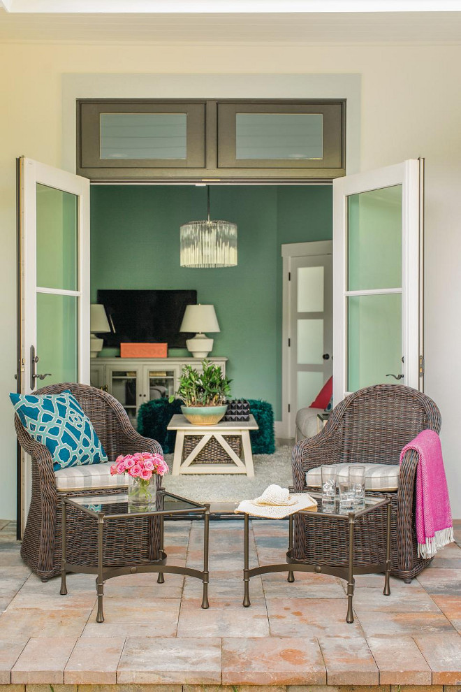 French Doors. A pair of French doors open the media room up to a side yard with seating area that fits perfectly with the indoor-outdoor Floridian lifestyle.