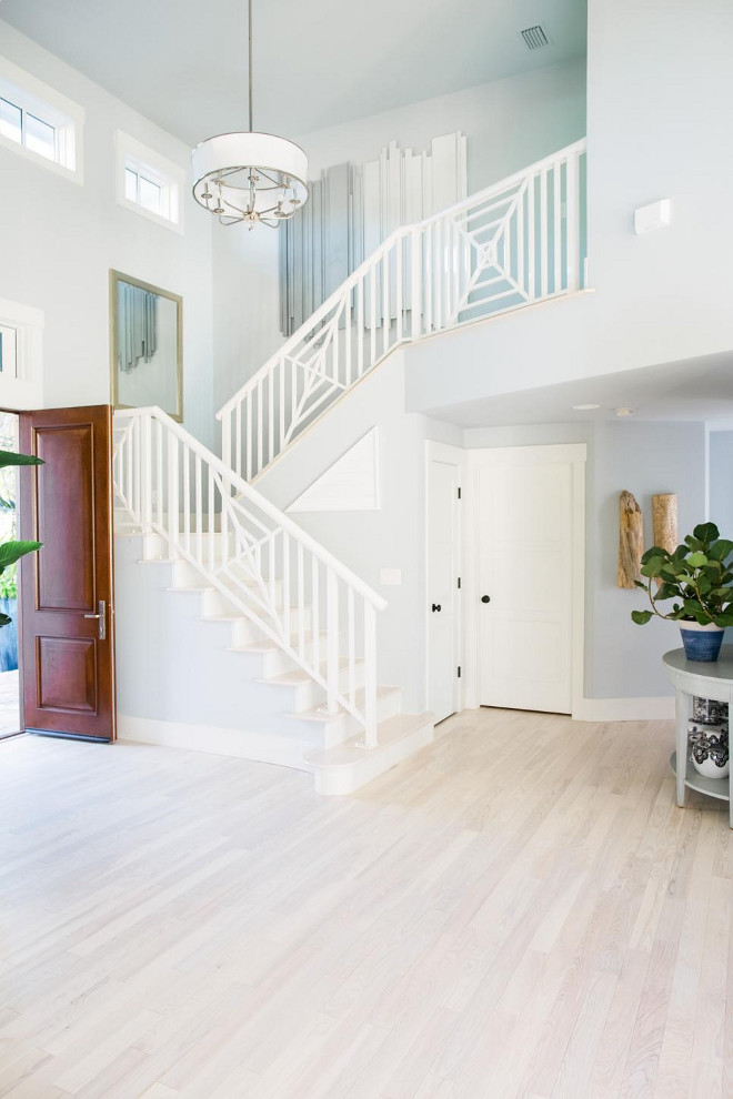 HGTV Dream Home 2016 Foyer. The foyer's chic geometric staircase railing to the upper level gives a hint of the home's luxe design motif and overall design approach.