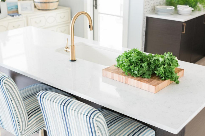 HGTV Dream Home 2016 Kitchen A clean, white, marbled surface on the kitchen island is the perfect backdrop for the patinated brass gooseneck faucet and under mounted sink.