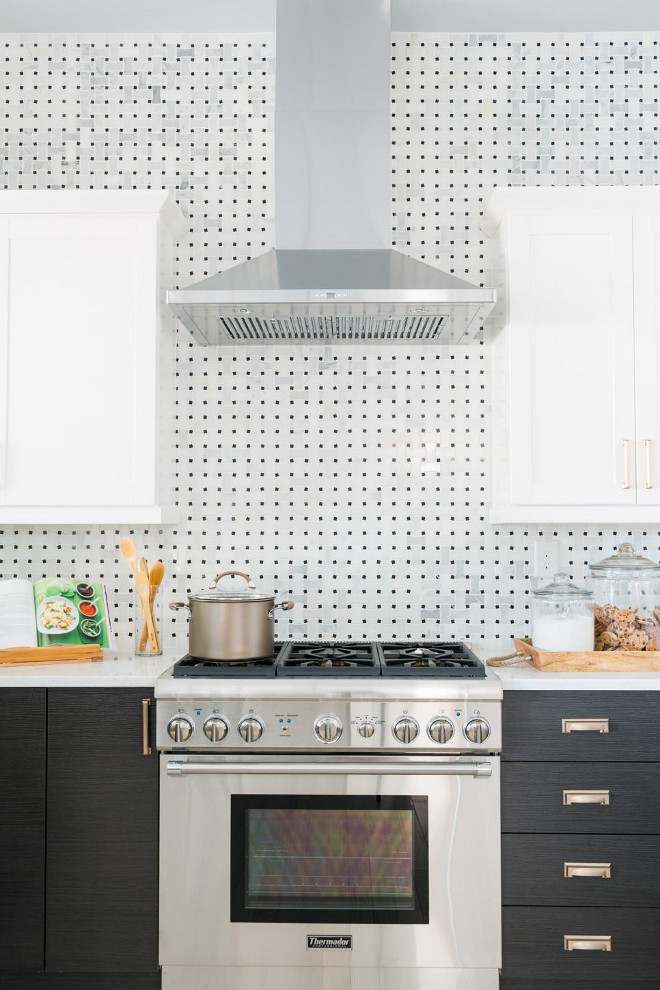 HGTV Dream Home 2016 Kitchen. The industrial looking range hood and chefs stove give the kitchen a restaurant feel