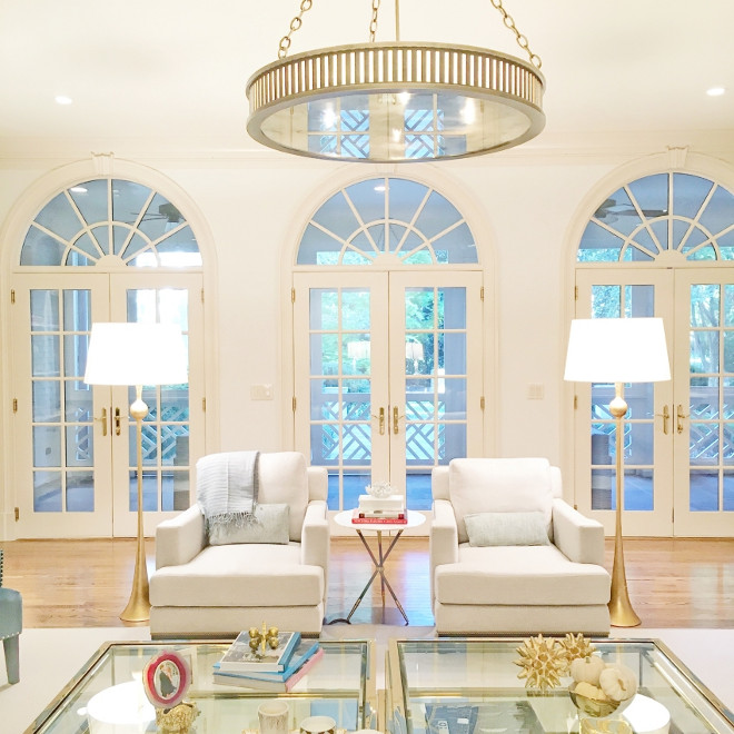 Living room arched doors. All-white living room with gold decor and arched doors. #Livingroom #archeddoors #Livingroomarcheddoors Fashionable Hostess.