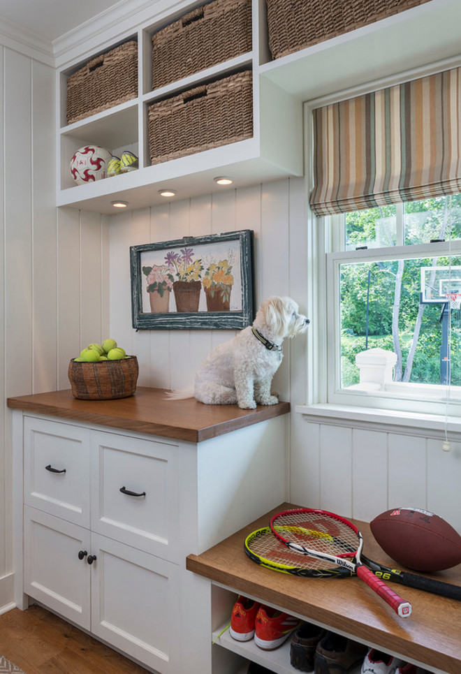 Mudroom Cabinet with counter. Making the most of small mudroom with cabinet, countertop and bench. #MudroomCabinet #MudroomCabinetcounter #Mudroom Taste Design Inc.