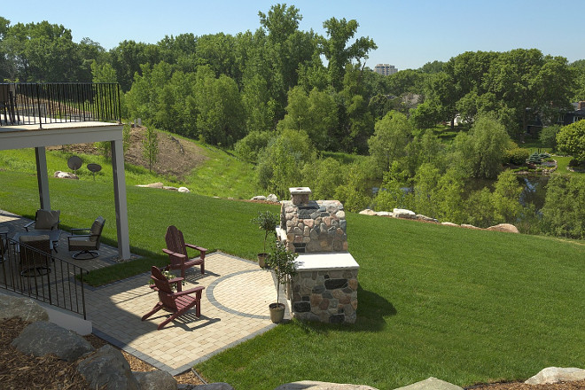 Outdoor Fireplace Backyard Layout. Patio and deck open to outdoor fireplace in this private backyard. #Backyard #OutdoorFireplace Spacecrafting Photography. Carl M. Hansen Companies.