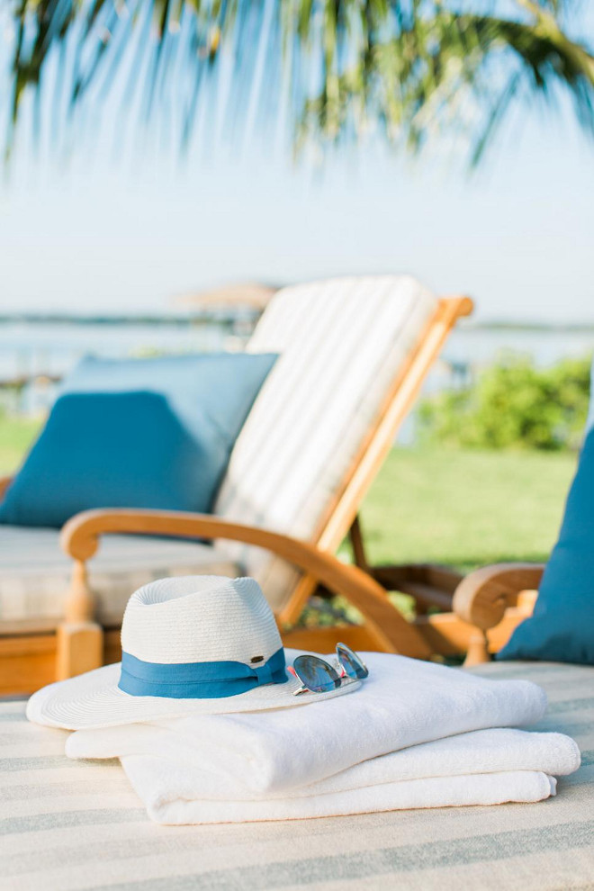 Pool Furniture. Fresh white towels, a wide-brim sun hat and dark shades allow friends and family to sit for hours on the lounge chairs on the sun deck.
