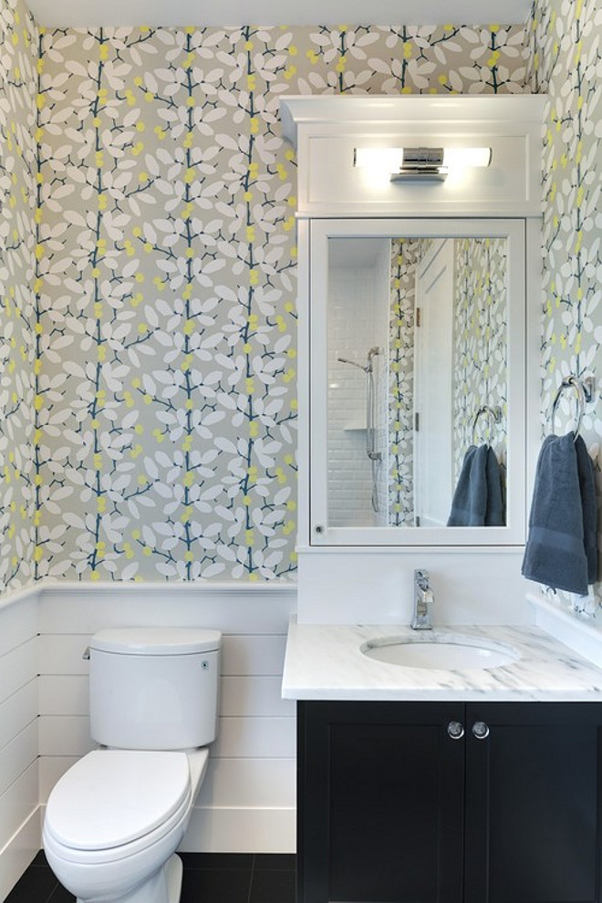 Powder room wallpaper. Fun Powder room wallpaper. Powder room wallpaper ideas. Powder room with half wall shiplap and wallpaper. The powder room features top half of walls with modern floral wallpaper and bottom half of walls with tongue and groove. #Powderroom #wallpaper