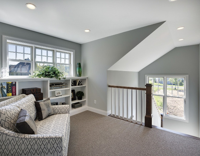 Staircase landing area with reading nook.  Spacecrafting Photography. Carl M. Hansen Companies.