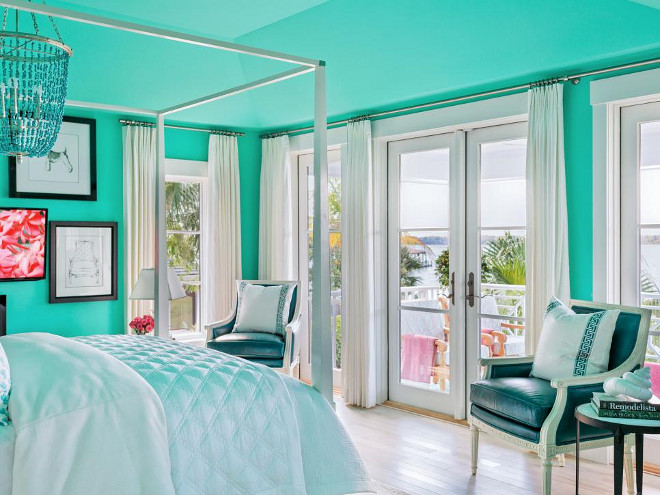Teal Bedroom. The majestic teal for the master bedroom walls was also used for the ceiling, which helps give the well-detailed space a cozy feel.