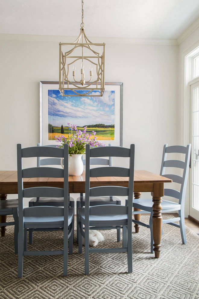 Update the tired look of your old chairs with fresh paint. The designer painted the old chairs from Pottery Barn with a gray paint by Benjamin Moore. #PaintedChairs