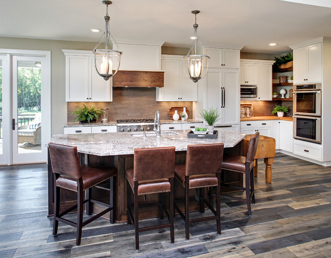 Warm Toned Kitchen. Warm Toned Kitchen Paint Color. Warm Toned Kitchen Paint color is Sherwin Williams SW 7031 MEGA GREIGE. Pillar Homes.